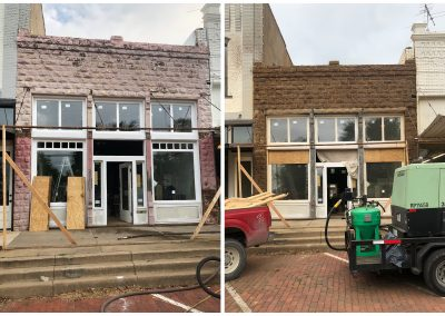 Cleaning a brick facade with sandblasting before and after